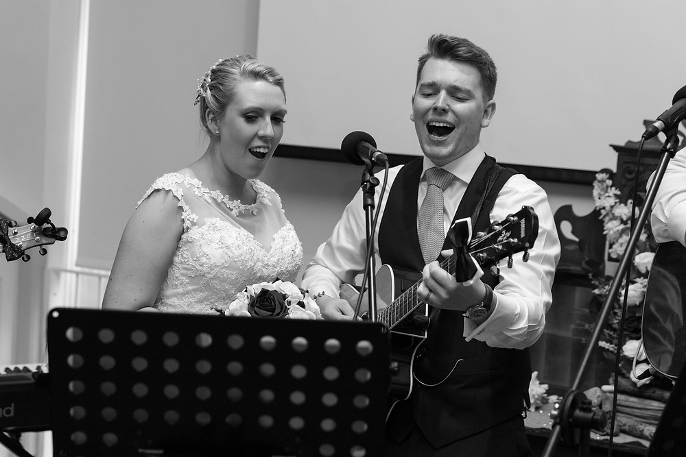 The Bride & Groom perform a song together