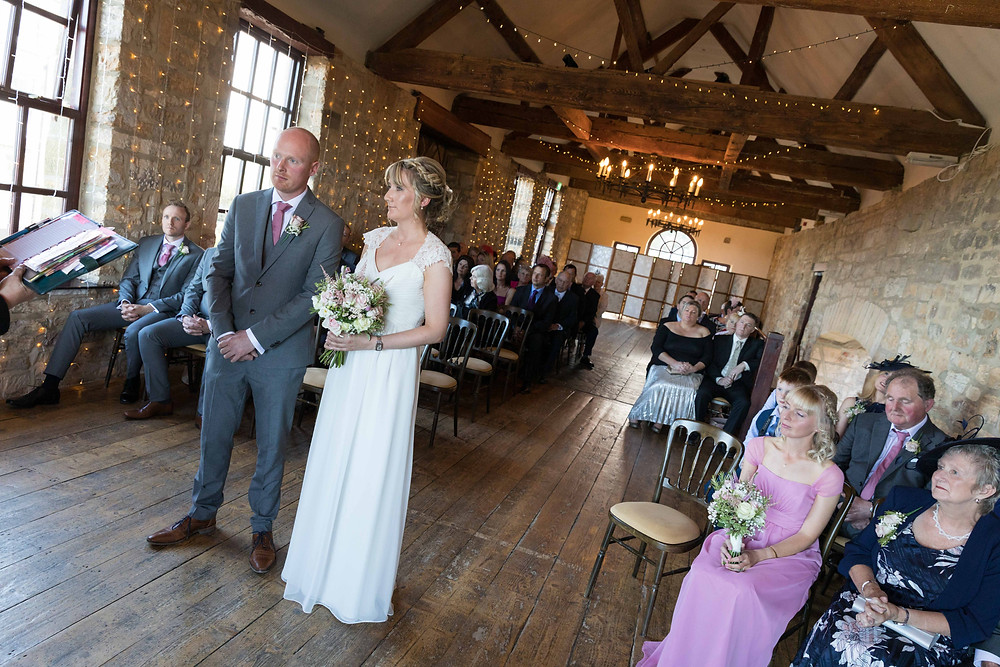 Bride & groom during the wedding ceremony by Whitby wedding photographer