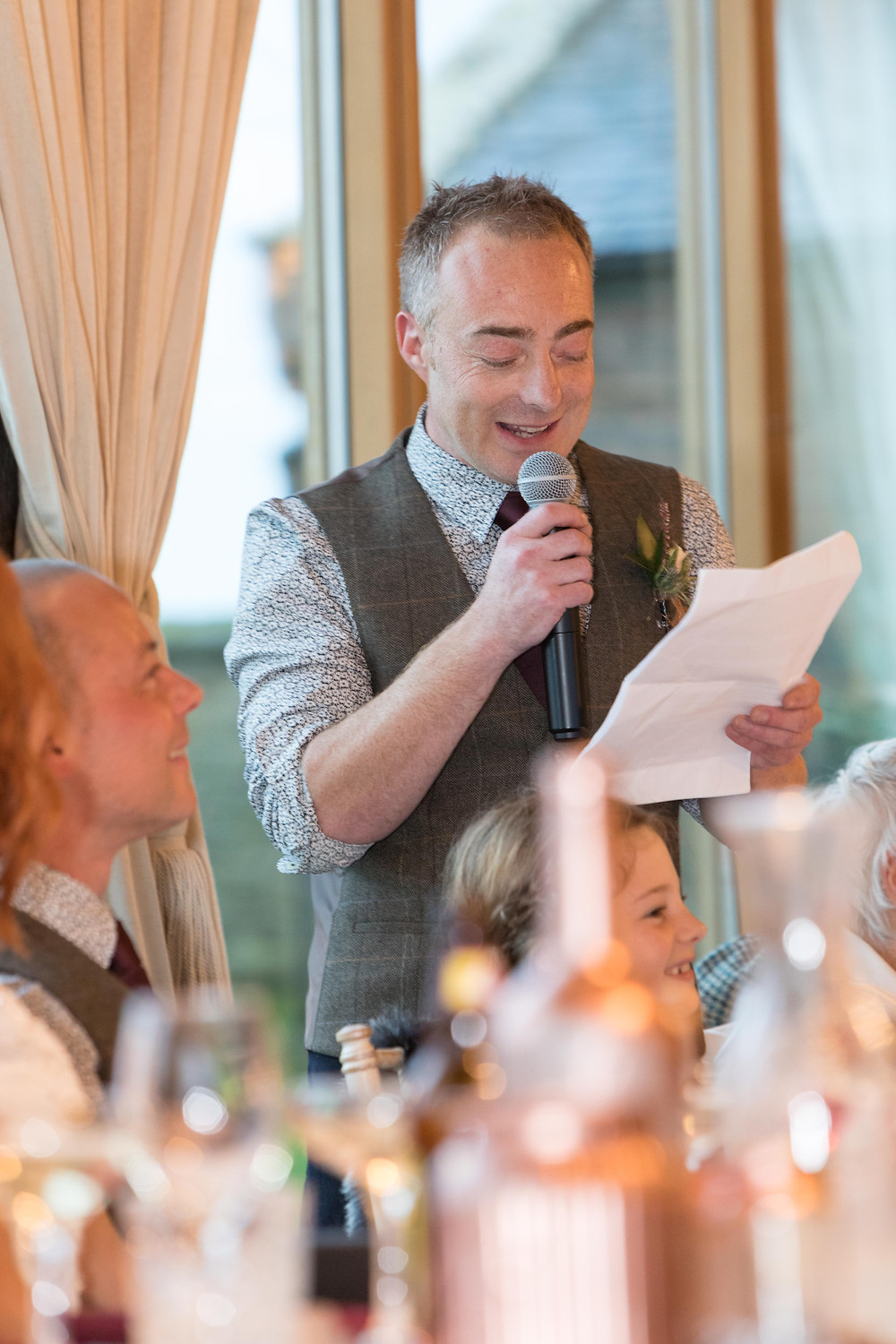 Wedding photograph of the best man during his speech