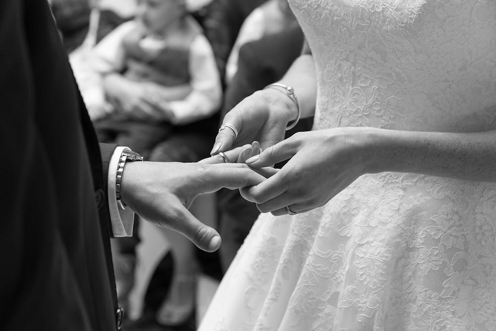 The bride & groom exchanging wedding rings by Jack Cook