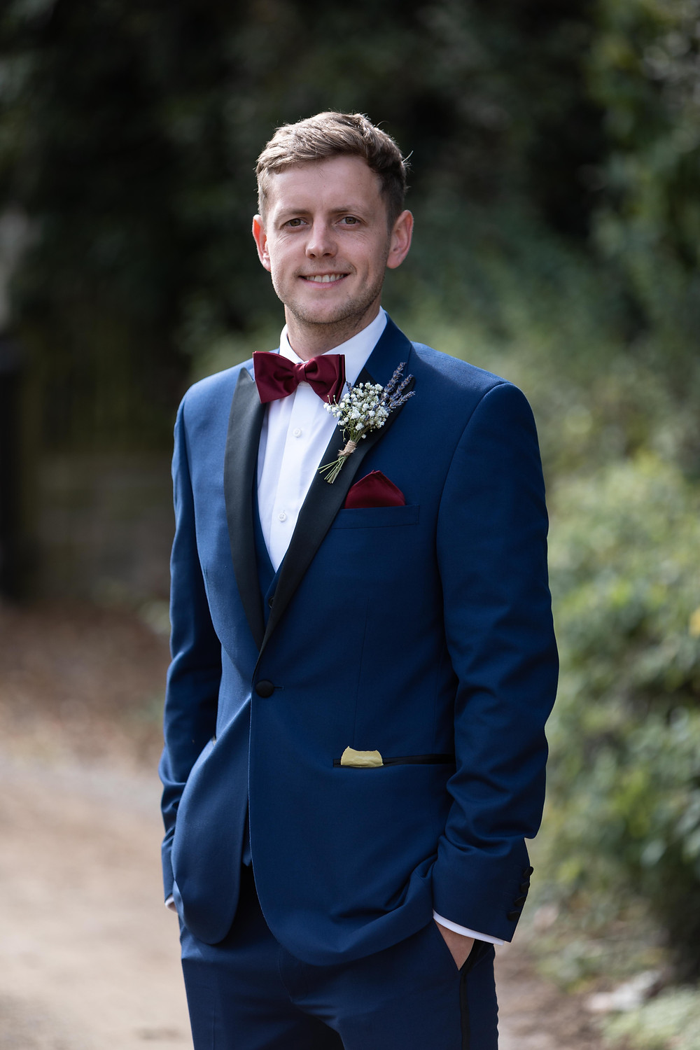 Wedding portrait of the groom smiling