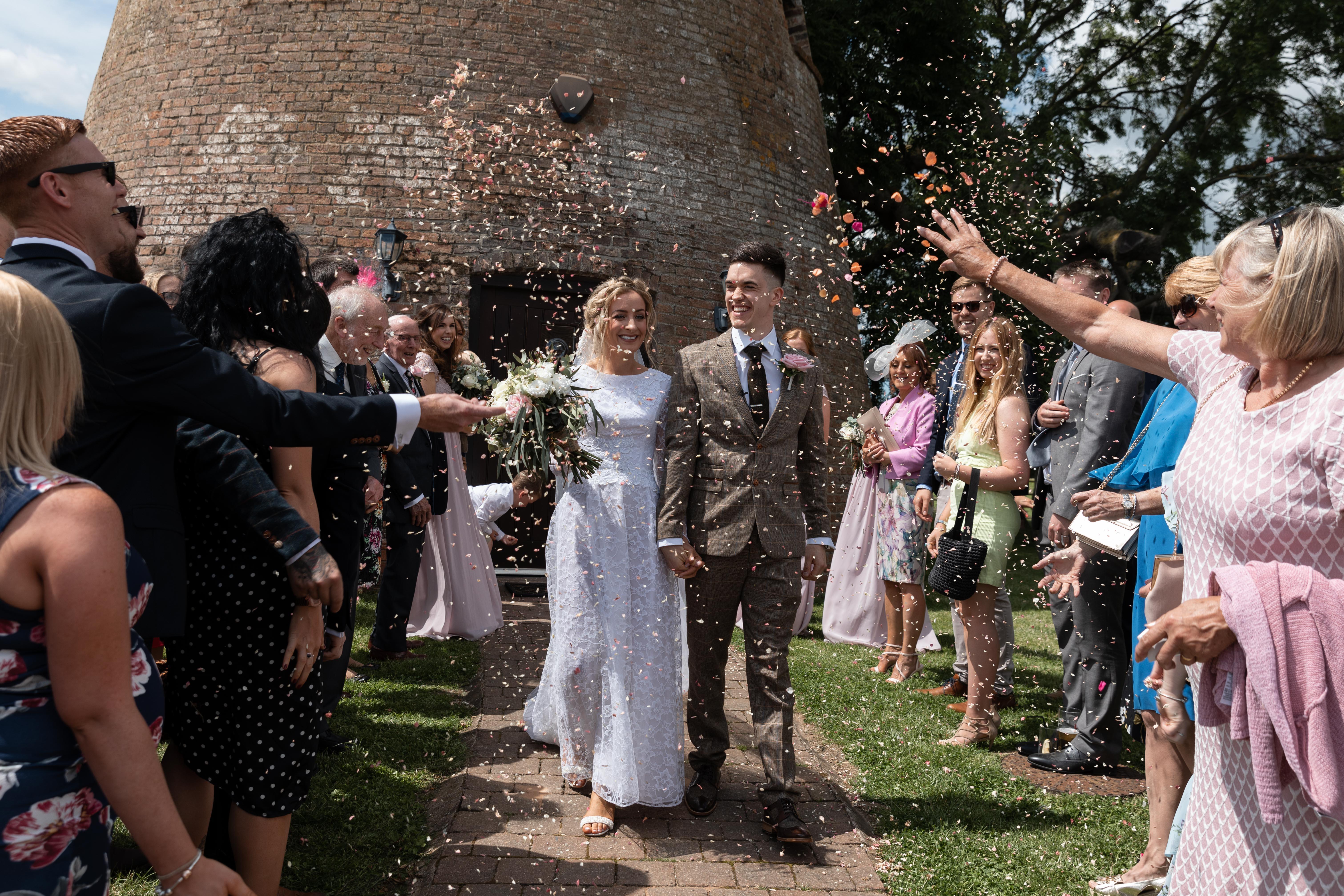 The bride & groom confetti photo