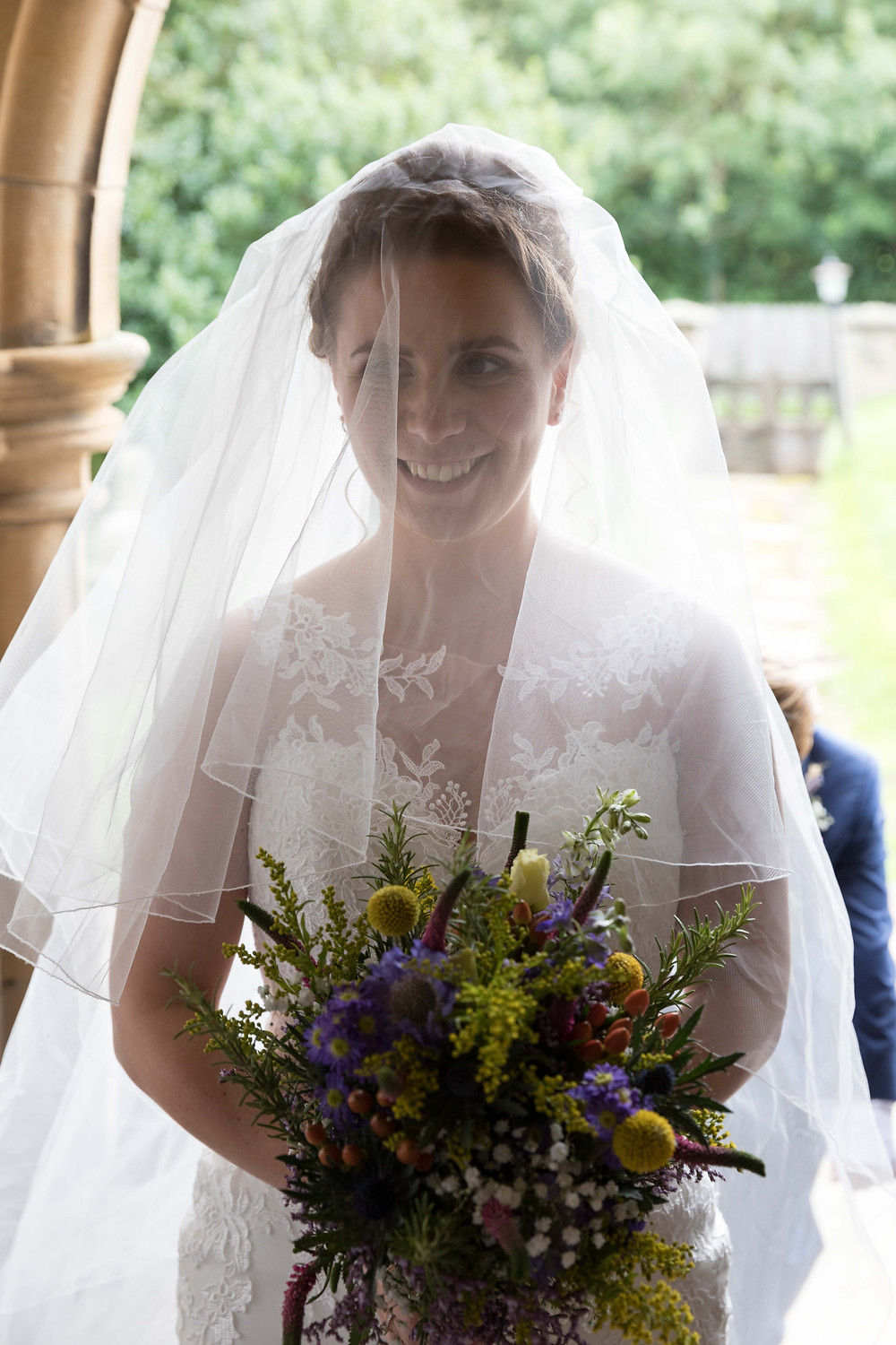 The bride smiling by Yorkshire wedding photographer