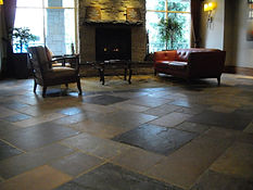 Stone tiles (Bluestone) floor, after advanced cleaning and restoration. Sealed with MetaCreme.
