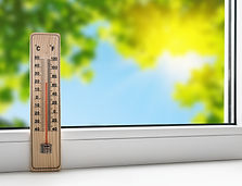 thermometer on the windowsill on the bac