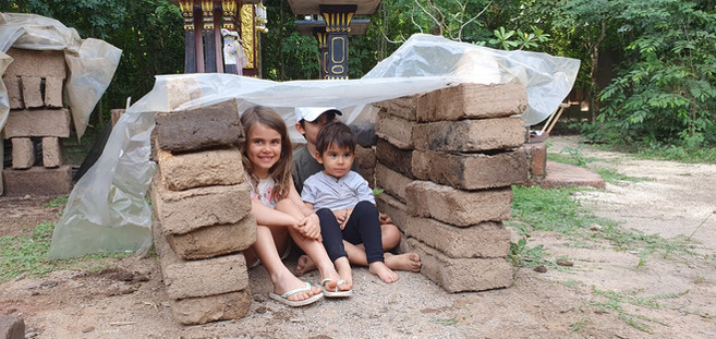 Kiddos in the mud bricks