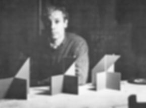 Will Insley in his apartment with structural models