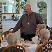 Father Charlie entertains the ladies!