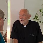 Kimberlea and Father Steve commiserate . . .