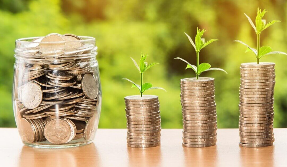 moedas- crescimento financeiro- pote de moedas