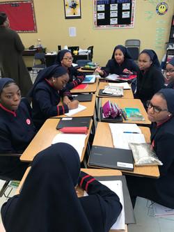 Sisters debating in english class