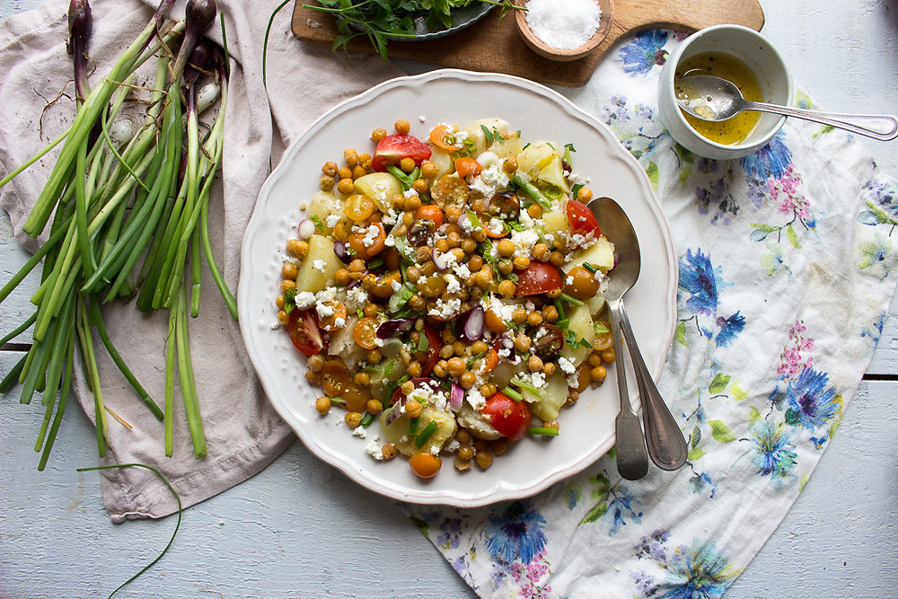 Photo of a summer salad with feta and crispy chickpeas