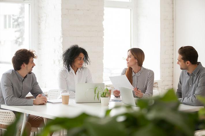 multiracial-male-female-colleagues-havin