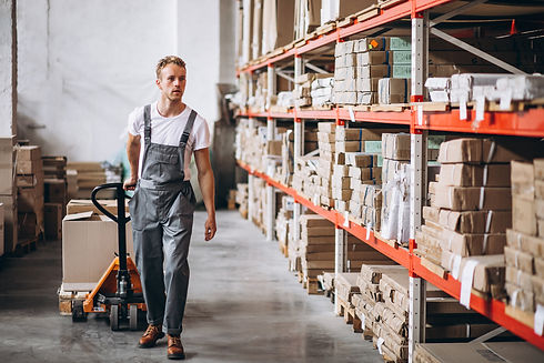 young-man-working-at-warehouse-with-boxe