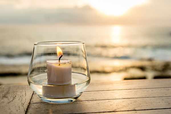Candle on a table at an ocean view cafe,