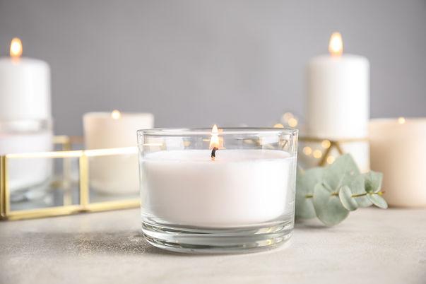 Burning aromatic candle and eucalyptus b