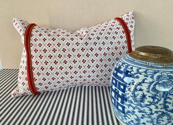 Anna Spiro's Paniola Red Cushion with vintage Trim