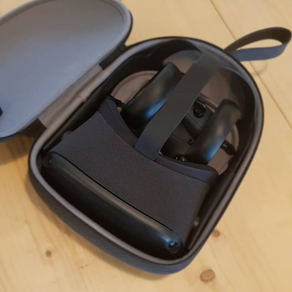 The Oculus Quest virtual reality headset and controllers in a carrying case.