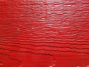 Red with a hint of black in the grain