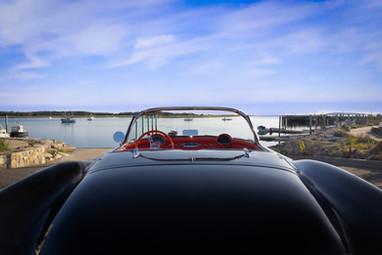 View to a Kill. 1956 Corvette overlooking Wellfleet Harbor @autosaggio