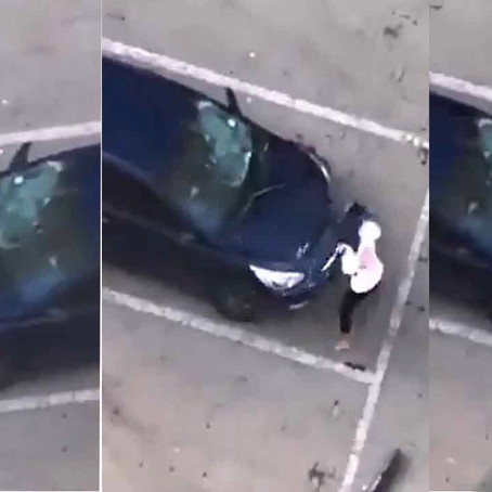 Wife destroys husband's car after catching him with mistress [Watch Video]