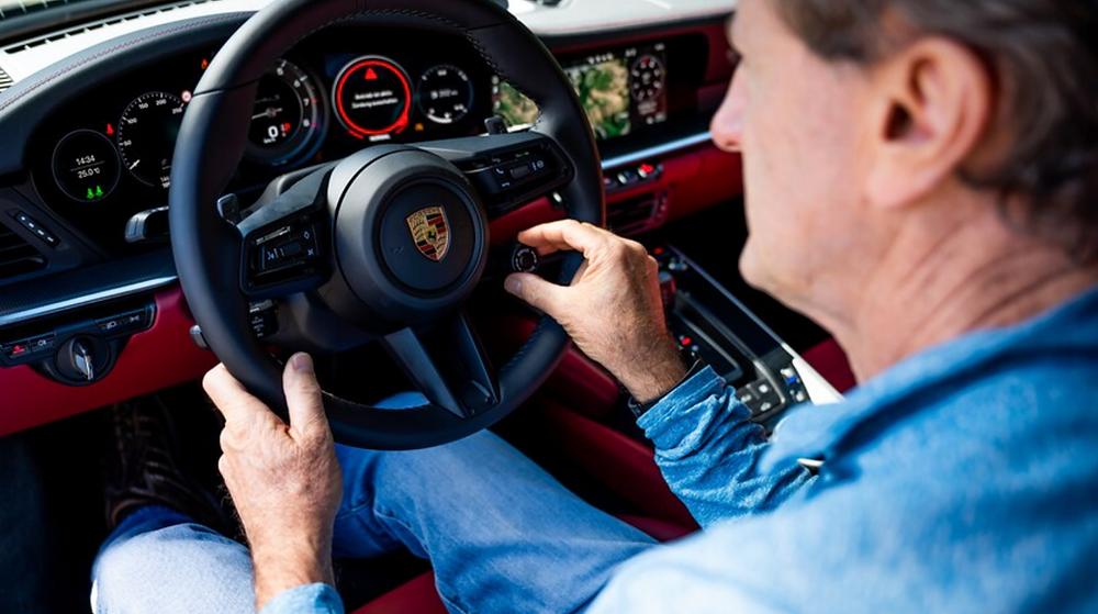 Andy Pilgrim studies the 911 Turbo interior.