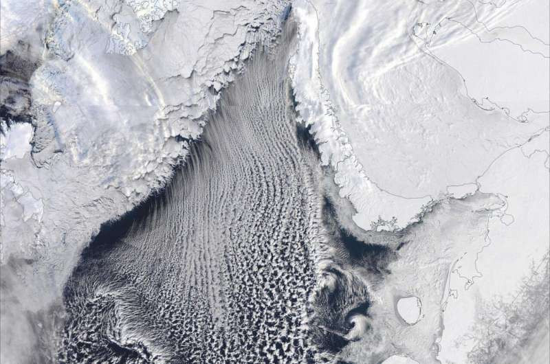 "The Beast from the East on March 15, 2018, captured on Aqua MODIS satellite images. Parallel cloud bands (""cloud streets"") extending across the southern part of the Barents Sea indicate convection rolls of warm, moist air rising from the ice-free surface. Photo: NASA"