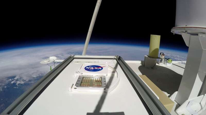 MARSBOx payload in the Earth's center stratosphere (38 km elevation). The shade is openly uncovering the top layer tests to UV radiation. Credit: NASA