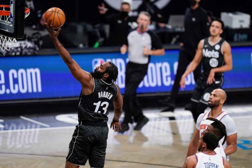 Brooklyn Nets 'James Harden, left, drives past New York Knicks' Taj Gibson, right, and Obie Toppin during the first half of an NBA basketball game on Monday. AP Photo/Frank Franklin II