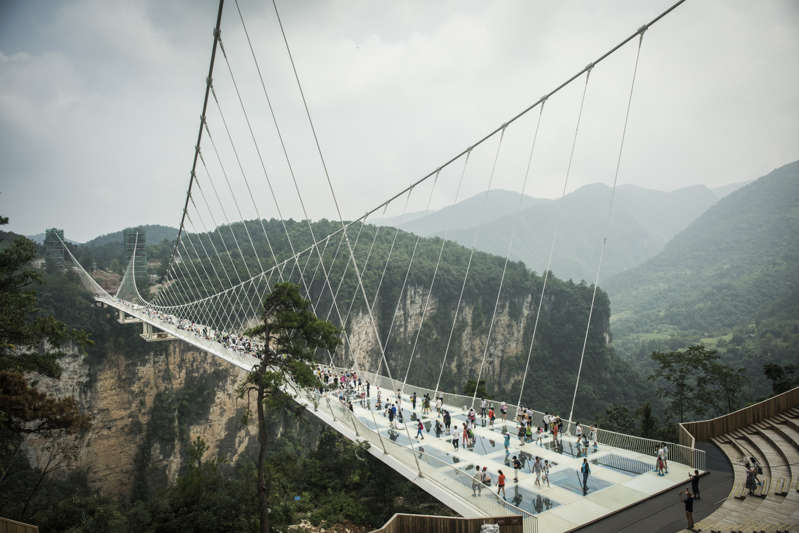 Chinese glass bridge breaks Leaving Tourists clinging to 330ft above ground