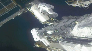 The astronauts are preparing the station for new solar wings