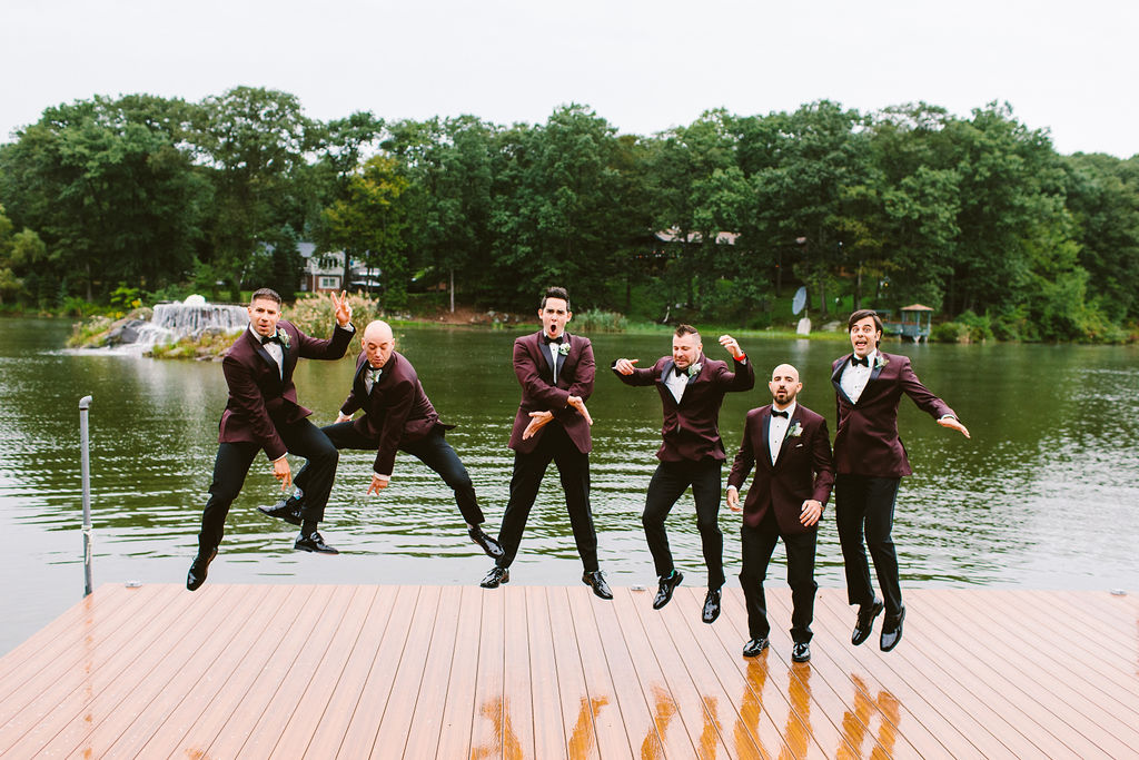 Groomsmen Jumping Dock Rain