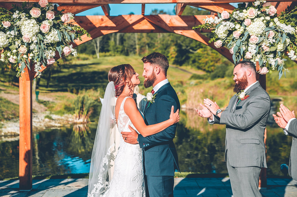 Outdoor, waterfront wedding ceremony in Northern New Jersey.