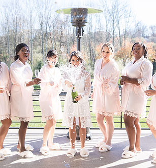 Bridal Party Popping Champagne.jpg