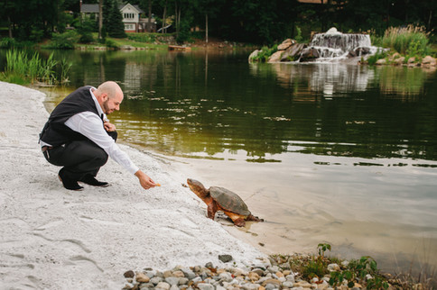 Mike Feeding the Turtles