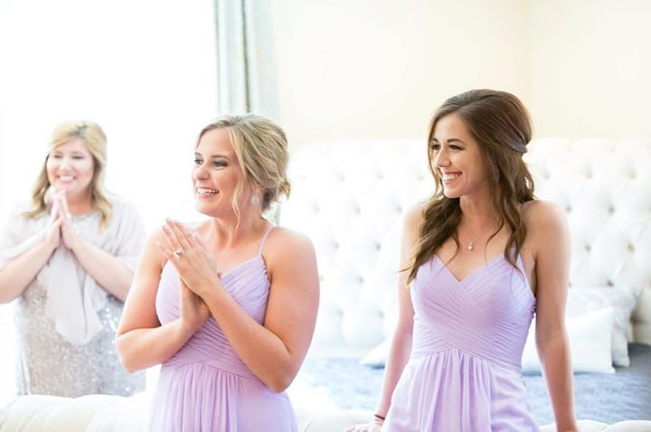 The joy on the bridesmaids and moms faces when seeing the bride in her dress the first time is such