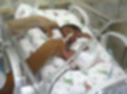 Rolled Up accommodates a premature baby in incubator