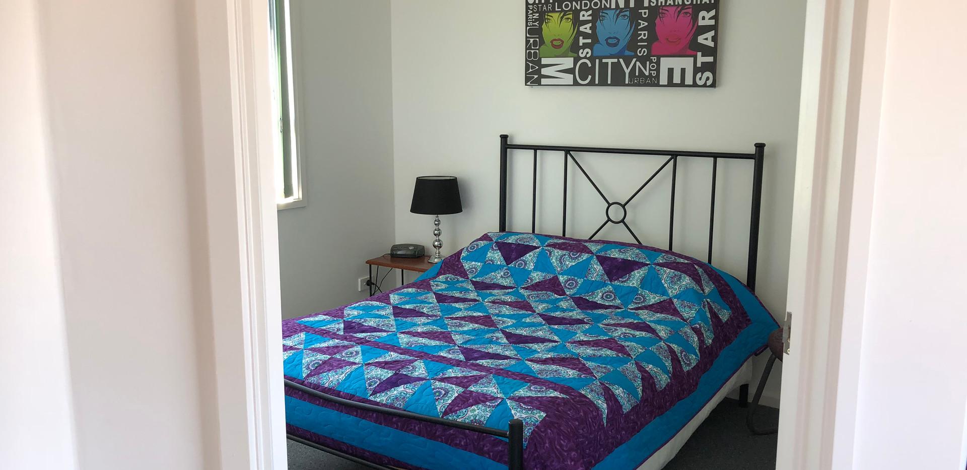 Grandma's Cabin 2 main bed.jpg