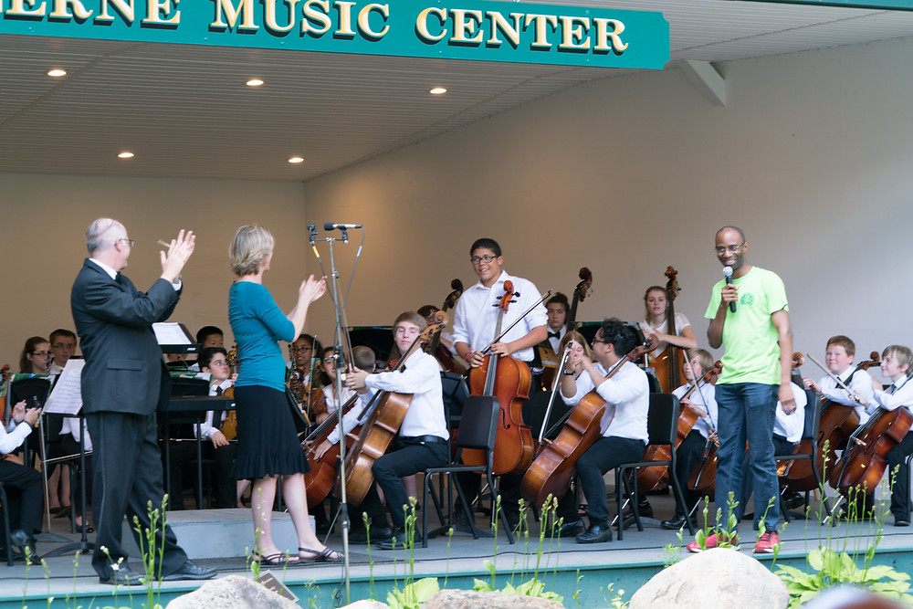 LMC alum ('88,'89) Glen Inanga of the Caymen Arts Festival recognizes Dequan at a Junior Orchestra Concert in July.