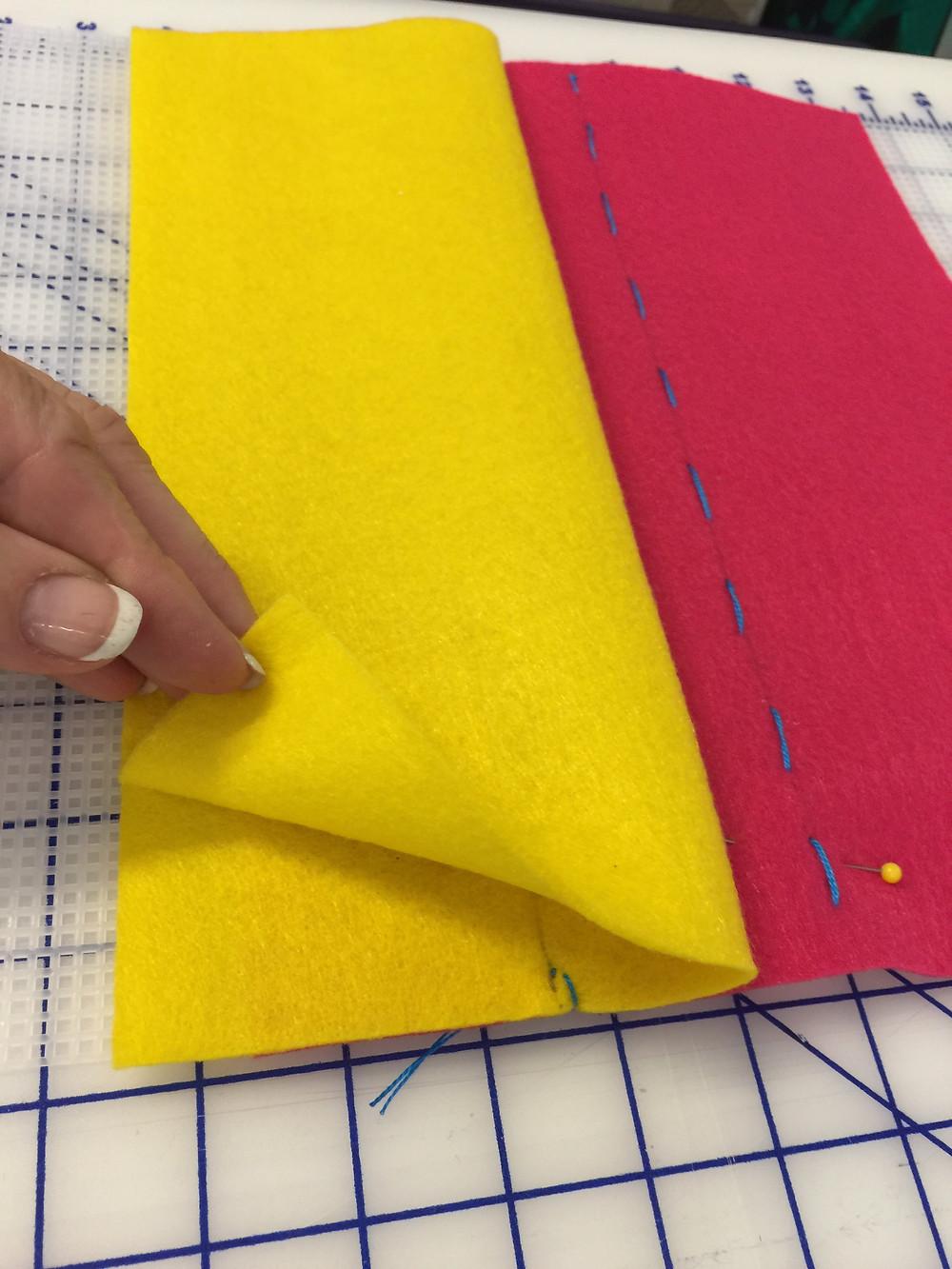 Folding Felt B so lower edges align.