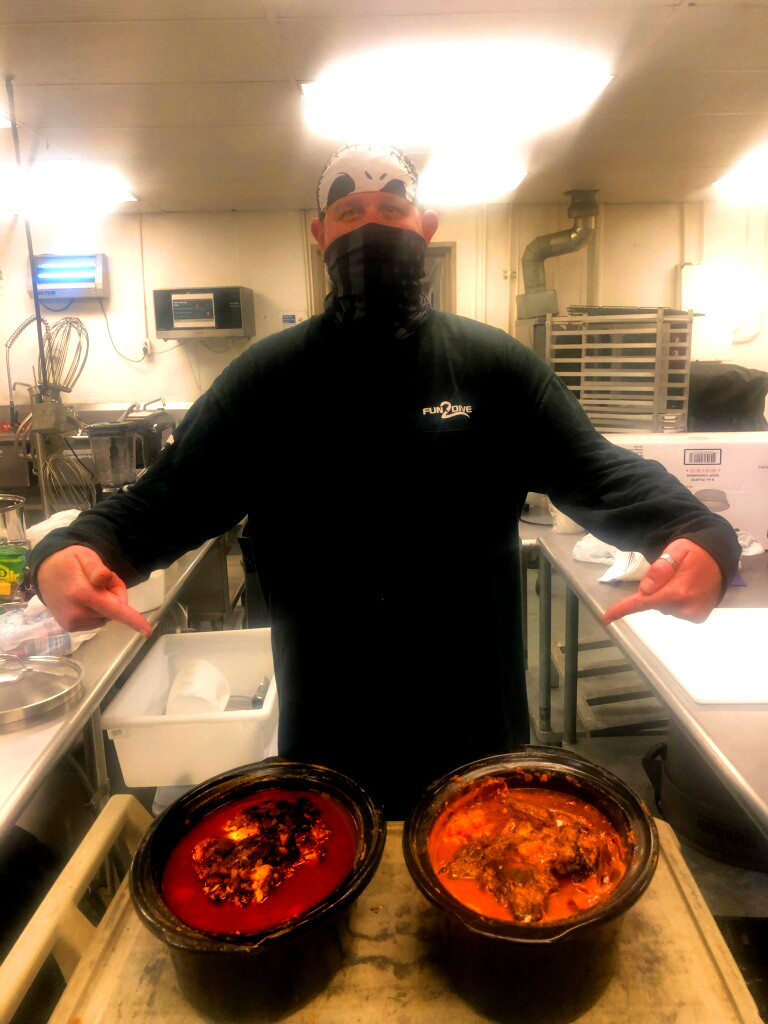 Kook in the kitchen with finished pork butts for Pork Green Chile and Street Pastor