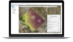 Laptop view of Integrated Geomancy ArcGIS Add-In results for Full Field Optimization in Oil and Gas planning.