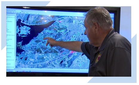 Harry Blackmore, team coordinator for Rovers Search and Rescue, points to a map used in the search for the missing Jonathan Hannaford in Newfoundland and Labrador.