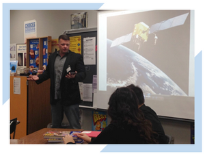 Darren Tompkins of Integrated Informatics Inc. talks to eighth-grade students on Career Day talking about GIS careers.