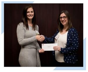 Sharon Janes of Integrated Informatics in St. John's, NL hands scholarship award to Victoria Pollard, Engineering student at Memorial University of Newfoundland.