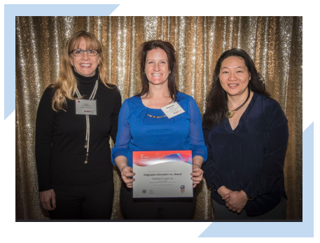 Lori Odegard and Tania Chan of Integrated Informatics Inc. recognize scholarship award recipient Stephanie Lapointe at the Southern Alberta Institute of Technology (SAIT).