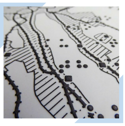Article showcasing a map designed for the blind, offering a tactile component to the map surface.