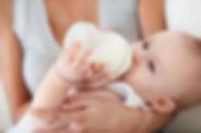 mother-feeding-newborn-a-bottle_pdzpvn.j
