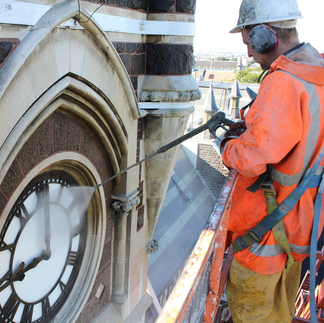 Cleaning Clock Tower, University of Otag