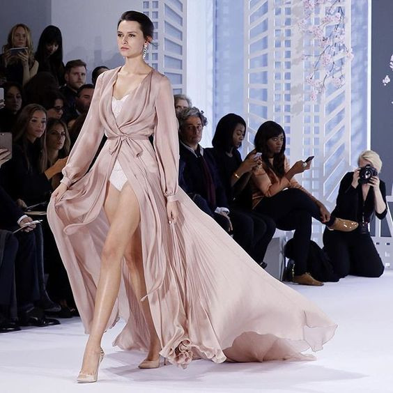 Nude silk satin chiffon robe with pleated godets. #ralphandrusso #couture #ss16…